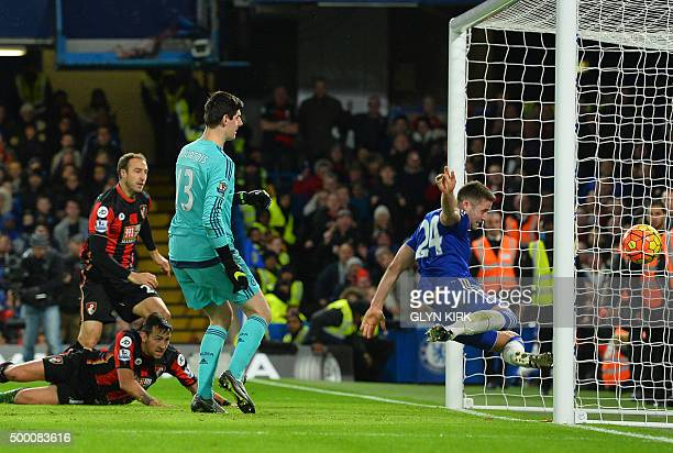 Bournemouth's English striker Glenn Murray scores past Chelsea's English defender Gary Cahill during the English Premier League football match...