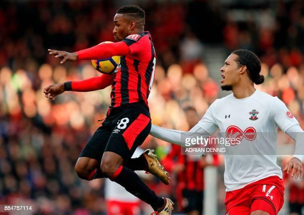Bournemouth's English striker Jermain Defoe controls the ball under pressure from Southampton's Dutch defender Virgil van Dijk during the English...