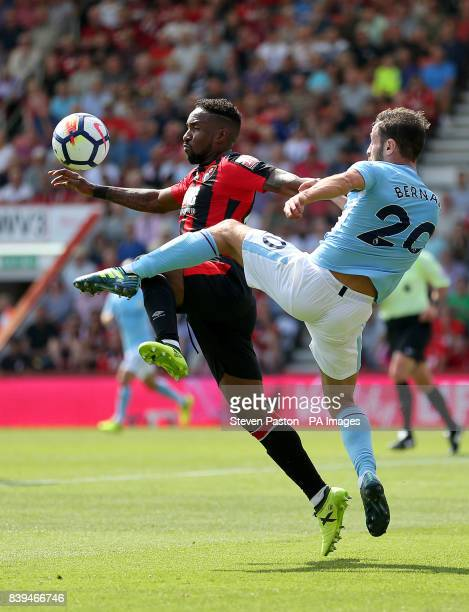 AFC Bournemouth's Jermain Defoe and Manchester City's Bernado Silva battle for the ball during the Premier League match at the Vitality Stadium...