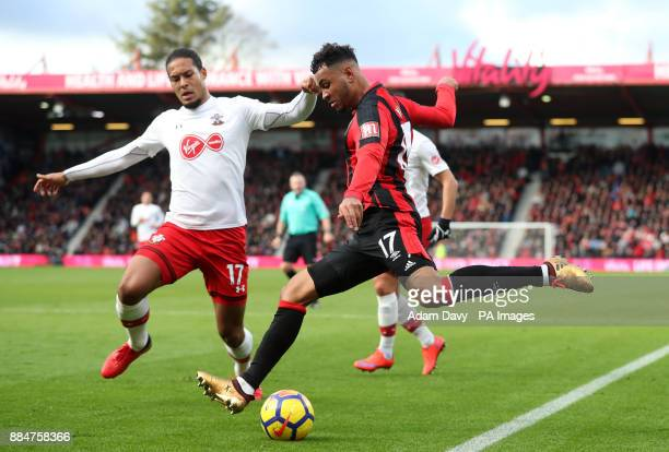 AFC Bournemouth's Joshua King and Southampton's Virgil van Dijk battle for the ball during the Premier League match at the Vitality Stadium...
