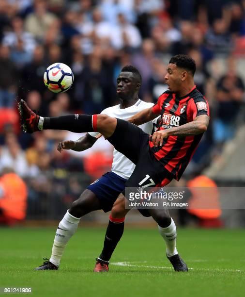 AFC Bournemouth's Joshua King and Tottenham Hotspur's Davinson Sanchez battle for the ball during the Premier League match at Wembley Stadium London