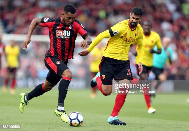 AFC Bournemouth's Joshua King and Watford's Miguel Britos battle for the ball during the Premier League match at the Vitality Stadium Bournemouth