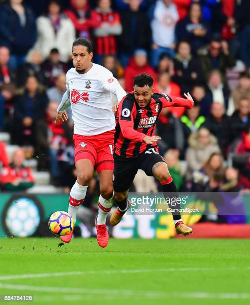 Bournemouth's Joshua King battles for possession with Southampton's Virgil van Dijk during the Premier League match between AFC Bournemouth and...