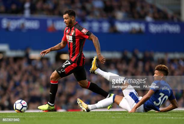 AFC Bournemouth's Joshua King gets away from the tackle from Everton's Mason Holgate during the Premier League match at Goodison Park Liverpool