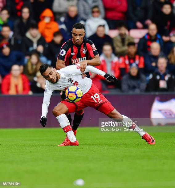 Bournemouth's Junior Stanislas battles with Southampton's Sofiane Boufal during the Premier League match between AFC Bournemouth and Southampton at...