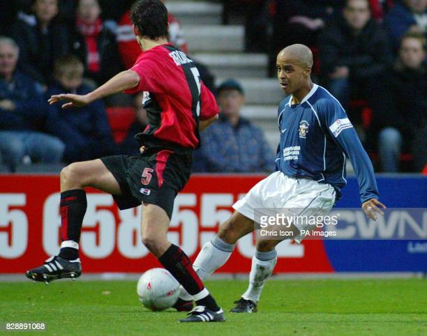 Bournemouth's Karl Broadhurst blocks a cross by Lutel James of Accrington Stanley during the FA Cup second round match at The Fitness First Stadium...