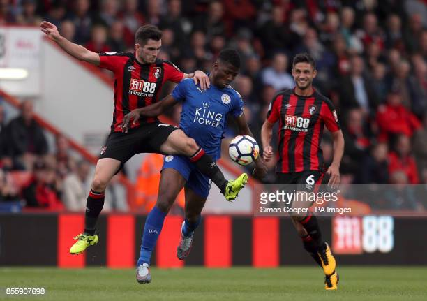 AFC Bournemouth's Lewis Cook and Leicester City's Kelechi Iheanacho battle for the ball during the Premier League match at the Vitality Stadium...