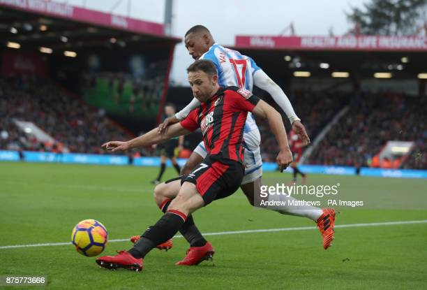 AFC Bournemouth's Marc Pugh and Huddersfield Town's Rajiv van La Parra battle for the ball during the Premier League match at the Vitality Stadium...