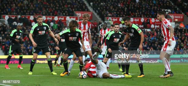 Bournemouth's Nathan Ake clears as Stoke City's Eric Maxim ChoupoMoting tries to regain control of the ball during the Premier League match between...