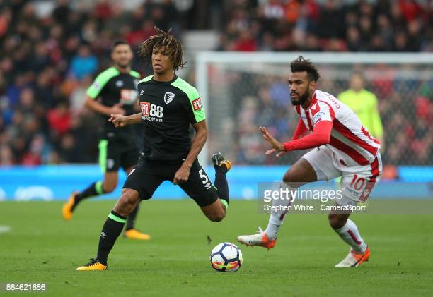 Bournemouth's Nathan Ake evades the tackle from Stoke City's Eric Maxim ChoupoMoting during the Premier League match between Stoke City and AFC...
