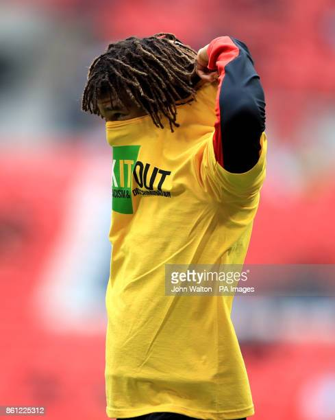 AFC Bournemouth's Nathan Ake warms up before the game wearing a Kick it Out t shirt before the Premier League match at Wembley Stadium London