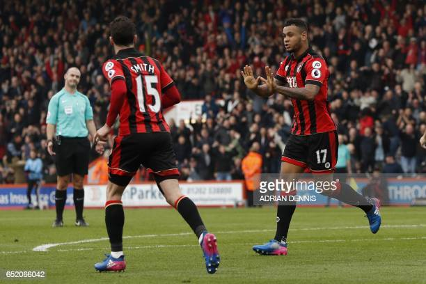Bournemouth's Norwegian striker Joshua King celebrates after scoring their first goal during the English Premier League football match between...