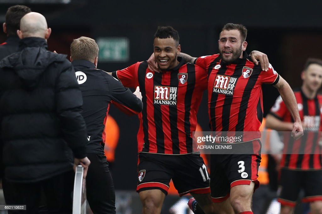 Bournemouth's Norwegian striker Joshua King (C) celebrates with Bournemouth's English defender Steve Cook (R) as he runs to Bournemouth's English manager Eddie Howe after scoring his third goal to give Bournemouth a 3-2 win in the English Premier League football match between Bournemouth and West Ham United at the Vitality Stadium in Bournemouth, southern England on March 11, 2017. Bournemouth won the game 3-2. / AFP PHOTO / Adrian DENNIS / RESTRICTED TO EDITORIAL USE. No use with unauthorized audio, video, data, fixture lists, club/league logos or 'live' services. Online in-match use limited to 75 images, no video emulation. No use in betting, games or single club/league/player publications. /