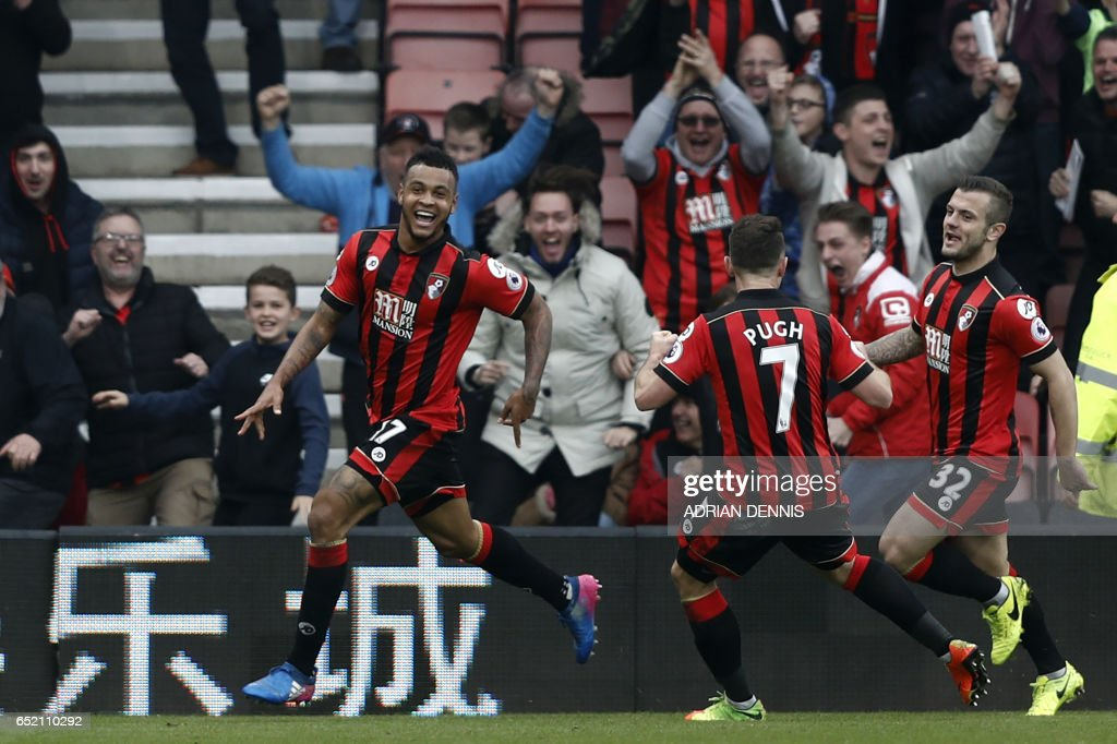 Bournemouth's Norwegian striker Joshua King (L) celebrates with teammates after scoring his third goal to give Bournemouth a 3-2 win in the English Premier League football match between Bournemouth and West Ham United at the Vitality Stadium in Bournemouth, southern England on March 11, 2017. Bournemouth won the game 3-2. / AFP PHOTO / Adrian DENNIS / RESTRICTED TO EDITORIAL USE. No use with unauthorized audio, video, data, fixture lists, club/league logos or 'live' services. Online in-match use limited to 75 images, no video emulation. No use in betting, games or single club/league/player publications. /
