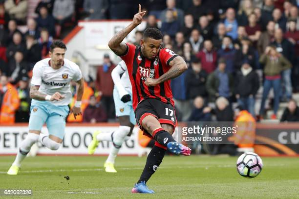 Bournemouth's Norwegian striker Joshua King hits this early penalty wide during the English Premier League football match between Bournemouth and...