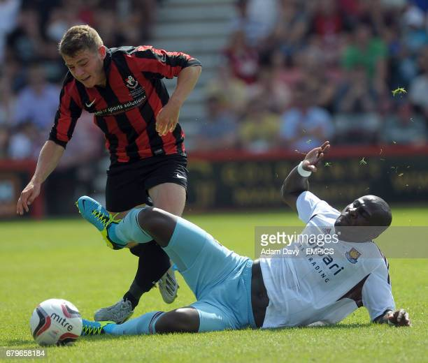 Bournemouth's Ryan Fraser and West Ham United's Guy Demel battle for the ball