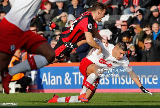 Bournemouth's Scottish midfielder Ryan Fraser vies with Southampton's French defender Jeremy Pied during the English Premier League football match...