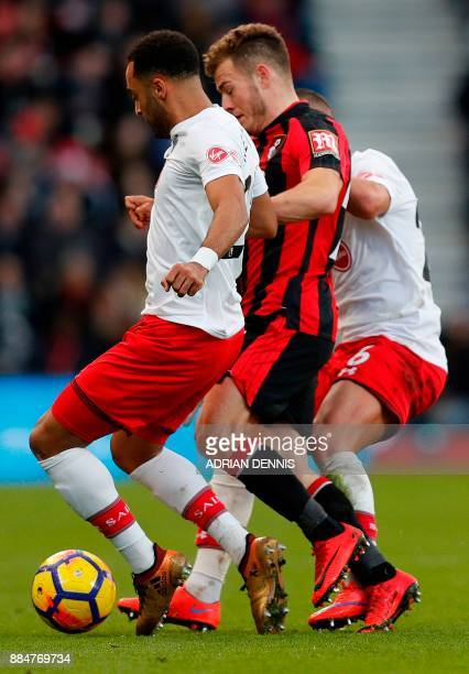 Bournemouth's Scottish midfielder Ryan Fraser vies with Southampton's English midfielder Nathan Redmond and Southampton's French defender Jeremy Pied...