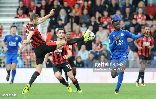 Bournemouth's Simon Francis controls the high ball while under pressure from Leicester City's Wilfred Ndidi during the Premier League match between...