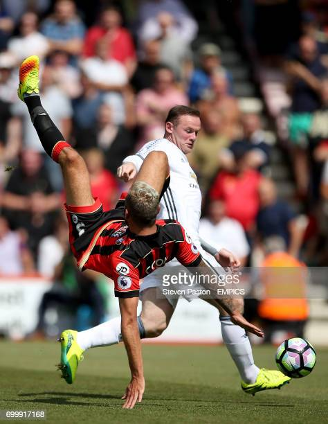 AFC Bournemouth's Steve Cook and Manchester United's Wayne Rooney in action