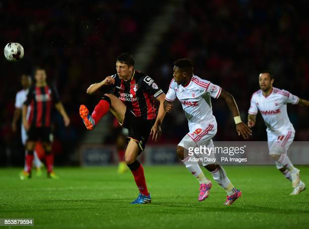 Bournemouth's Tommy Elphick and Nottingham Forest's Britt Assombalonga battle for the ball during the Sky Bet Championship match at Goldsands Stadium...