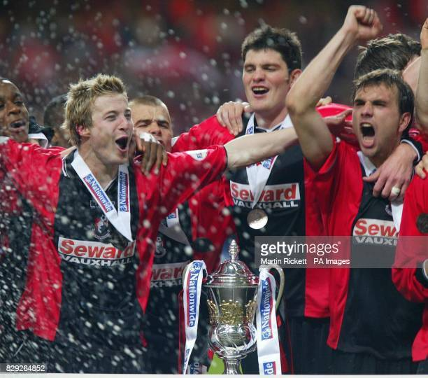 Bournemouth's Wade Elliot Marcus Browning and Carl Fletcher celebrate with the trophy after their 52 win against Lincoln City in theNationwide...