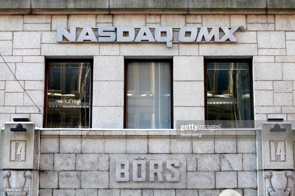 A 'bourse' logo sits above the entrance to the Helsinki stock exchange, operated by Nasdaq OMX Group Inc., in Helsinki, Finland, on Thursday, Jan. 17, 2013. Pedestrians pass a display of mobile phones in the window of a Nokia Oyj store in Helsinki, Finland, on Thursday, Jan. 17, 2013. The pace of Finland's debt growth is alarming and the country must undertake economic reforms together with reining in spending, Finnish Prime Minister Jyrki Katainen said in an op-ed piece published in newspaper Savon Sanomat. Photographer: Ville Mannikko/Bloomberg via Getty Images
