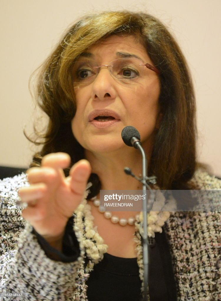 Bouthaina Shaaban, a cabinet-level adviser to Syrian President Bashar al-Assad, addresses journalists at the India Islamic Centre in New Delhi on March 8, 2013. A top Syrian regime official thanked the BRICS group of emerging powers March 8 for its support, which she said had prevented Western military intervention and the 'destruction' of the country. AFP PHOTO/RAVEENDRAN l