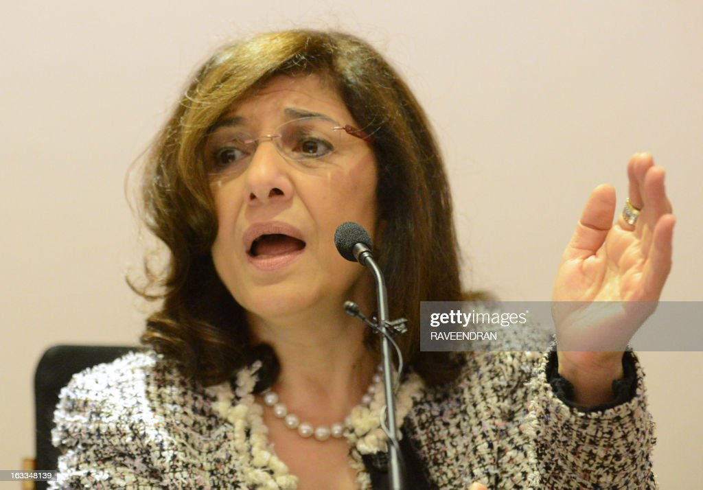 Bouthaina Shaaban, a cabinet-level adviser to Syrian President Bashar al-Assad, addresses journalists at the India Islamic Centre in New Delhi on March 8, 2013. A top Syrian regime official thanked the BRICS group of emerging powers March 8 for its support, which she said had prevented Western military intervention and the 'destruction' of the country. AFP PHOTO/RAVEENDRAN