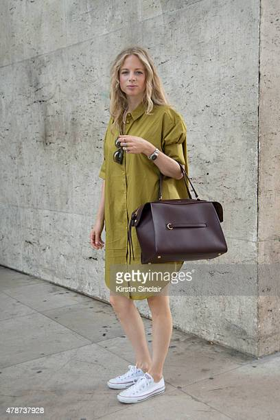 Boutique owner Georgina de Groot wears Acne dress Celine bag Celine sunglasses and All Stars sneakers on day 3 of Paris Collections Men on June 26...