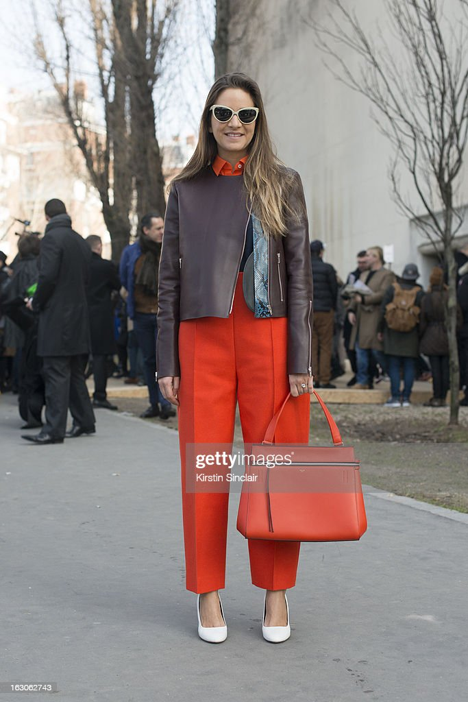 Boutique owner Laure Heriard du Breuil wears Prism sunglasses, Celine bag, trousers, jacket, shirt and shoes on day 4 of Paris Womens Fashion Week Autumn/Winter 2013 on March 03, 2013 in Paris, France.