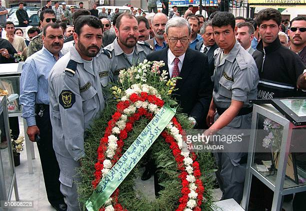 Boutros BoutrosGhali secretarygeneral of the francophone movement lays 29 April a wreath in the cemetery of 105 civilians who were killed by Israeli...