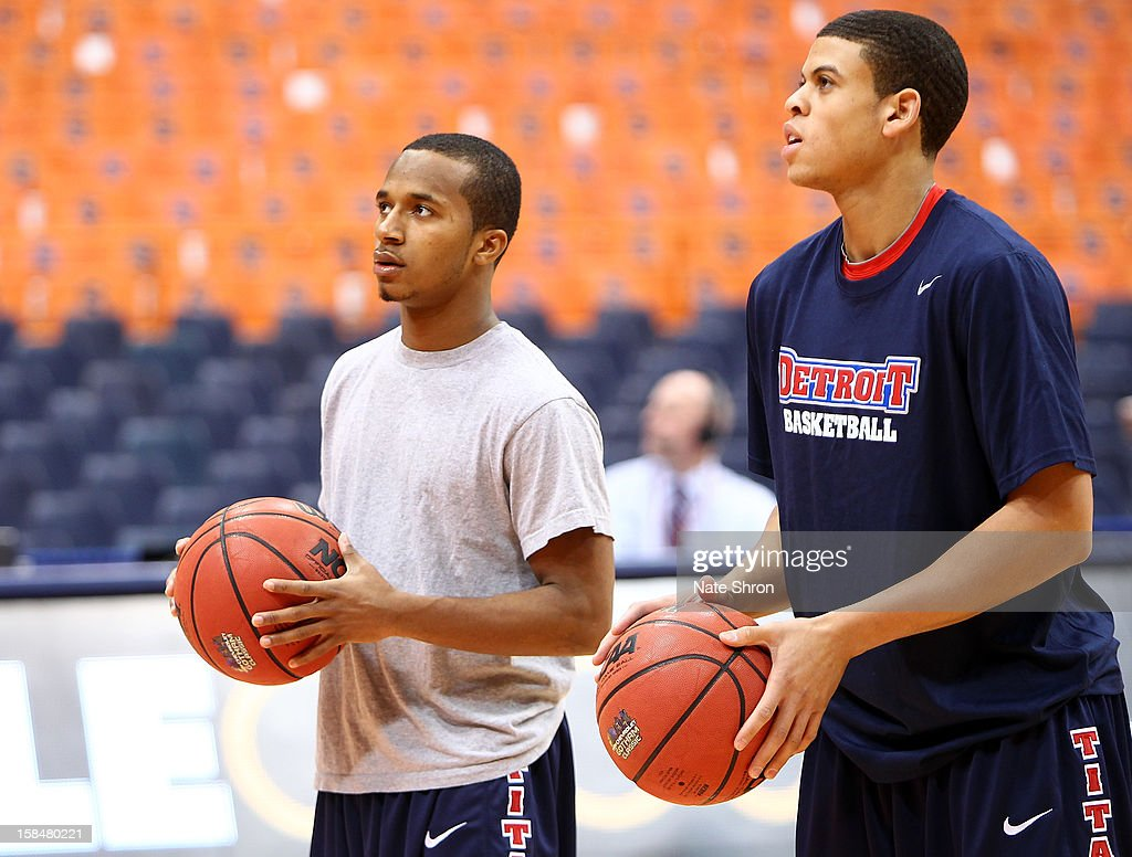 P.J. Boutte #11 (L) and Ray McCallum #3 (R) of the Detroit Titans prepare to shoot during warm ups on the court before the game against the Syracuse Orange at the Carrier Dome on December 17, 2012 in Syracuse, New York.