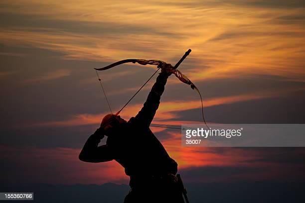 bow hunter sunset silhouette