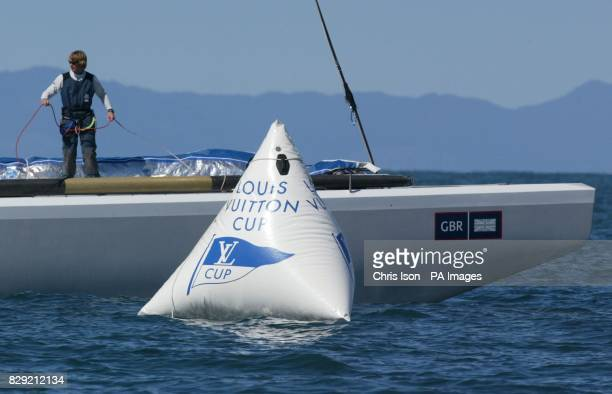 Bow man Matt Cornwell of Team GBR watches as his yacht Wight Lightning limps across the finishing line in the Hauraki Gulf off Auckland New Zealand...
