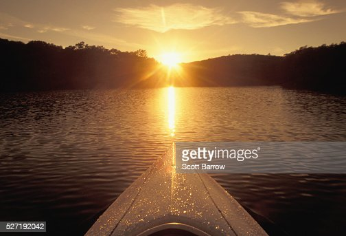 Bow of a kayak on a lake at sunset : Stock Photo