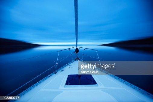 Bow of boat sailing on lake