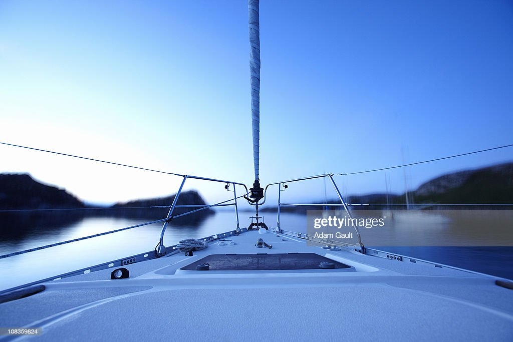 Bow of boat sailing on lake : Stock Photo