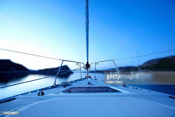 Bow of boat sailing on lake