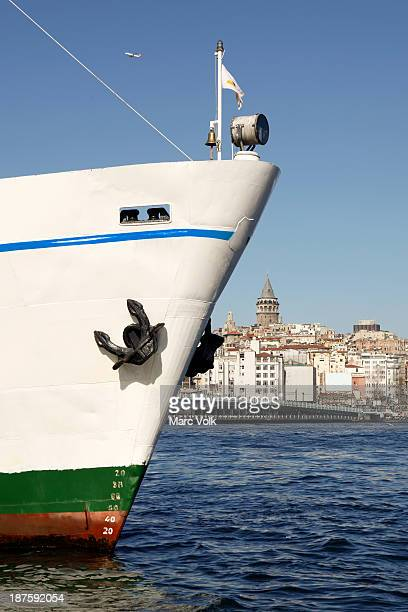 Bow of boat with background showing Galata Tower, Istanbul, Turkey