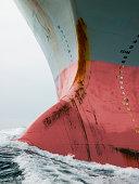 Bow of cargo ship in ocean.