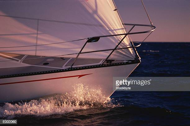 Bow of sailboat cutting through water