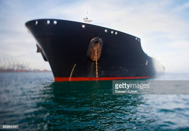 Bow view of navy blue oil tanker.