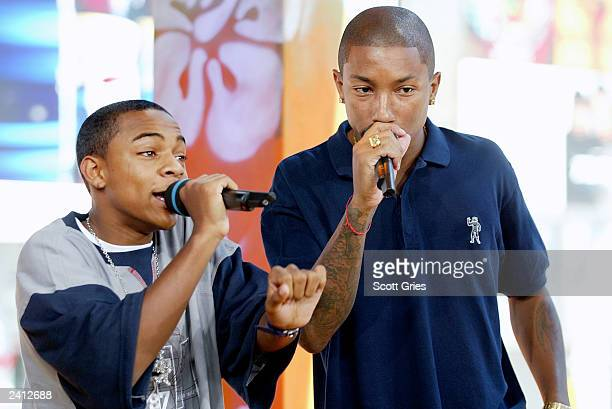 Bow Wow and Pharrell Williams of The Neptunes perform on stage during MTV's Total Request Live at the MTV Times Square Studios August 20 2003 in New...