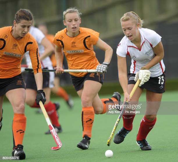 Bowdon's Fay Nash battles with Leicester's Gemma Darrington watched by Chloe Rogers during their EHL Premier League game at Bowdon HC Manchester