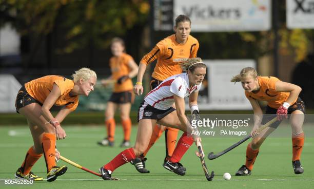 Bowdon's Nicky O'Donnell battles with Leicester's Lauren Turner and Lucy Brown during their EHL Premier League game at Bowdon HC Manchester