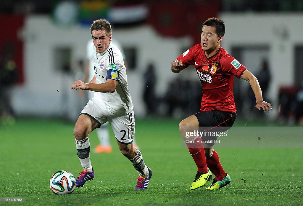 Bowen Huang of Guangzhou Evergrande FC chases Philipp Lahm of Bayern Muenchen during the FIFA Club World Cup Semi Final match between Guangzhou Evergrande FC and Bayern Muenchen at Agadir Stadium on December 17, 2013 in Agadir, Morocco.
