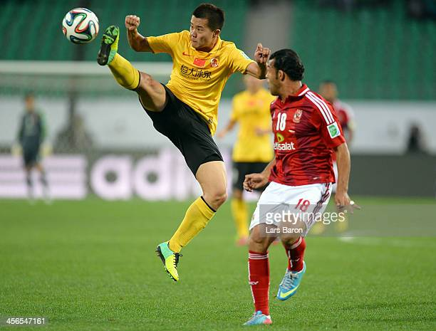 Bowen Huang of Guangzhou jumps for the ball next to Elsayed Hamdi of AlAhly during the FIFA Club World Cup quarterfinal match between Guangzhou...