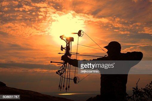 Bowhunter in Sunrise : Stock Photo