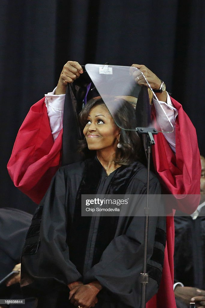Bowie State University Provost Weldon Jackson places a doctoral hood on U.S. first lady <a gi-track='captionPersonalityLinkClicked' href=/galleries/search?phrase=Michelle+Obama&family=editorial&specificpeople=2528864 ng-click='$event.stopPropagation()'>Michelle Obama</a> after she received an Honorary Doctor of Laws degree during the school's graduation ceremony at the Comcast Center on the campus of the University of Maryland May 17, 2013 in College Park, Maryland. Obama delivered the commencement speech for the 600 graduates of Maryland's oldest historically black university and one of the ten oldest in the country.